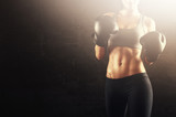 Boxing woman with gloves and strong body ready for training challenge
