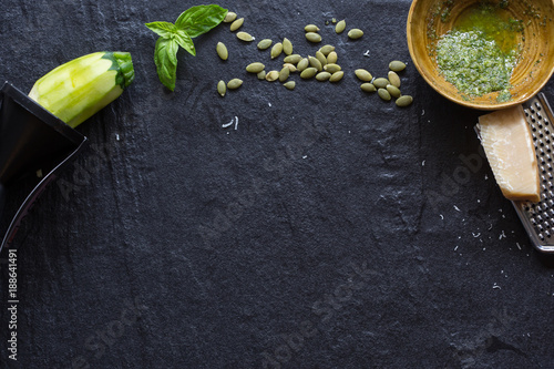 Foto Murales Healthy Vegetarian Black Board with Copy Space. Zucchini, seeds, Basil, and Pesto.