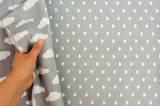 female hand touching grey cloth. copy space