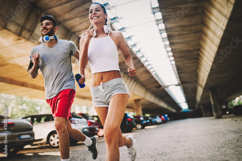Fotobehang Hardlopen Attractive man and beautiful woman jogging together