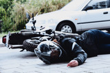 Dead motorcyclist on the road - 188672899