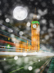 Big Ben at night with falling snow and full moon in London, UK. (Elements of this image furnished by NASA)
