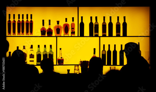 silhouette of people against of a bar