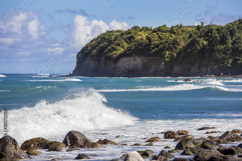 Foto Murales View of rocky beach and sea cliffs on St Kitts in the Caribbean sea.