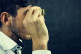 a man looks with binoculars - 188710293