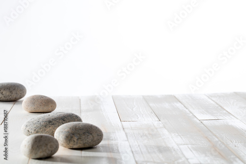 Tuinposter Spa grey pebbles for meditation, mindfulness, mineral spa or white emptiness