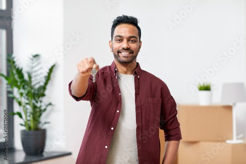 happy man with key moving to new home