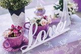 Wedding decorative elements and flowers on the table - 188724691
