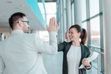 Two business people high-five. Job well done. - 188725620