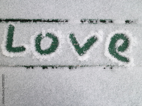 Poster Route 66 sign of love on a bench in the snow