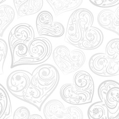 Seamless pattern of big hearts with ornament of curls, flowers and leaves, gray on white