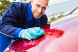 Happy Male Worker Cleaning Red Car - 188791844