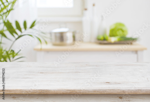 Leinwanddruck Bild Table top and blurred kitchen room as background