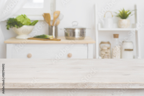 Table top and defocused kitchen interior as background