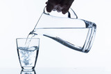 glass with water and pitcher