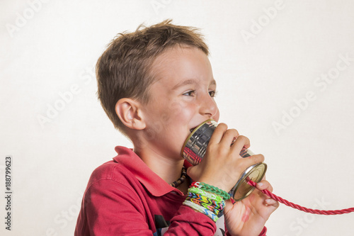 child with a can telephone