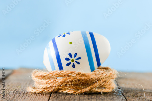Foto Murales Colorful Easter egg in nest
