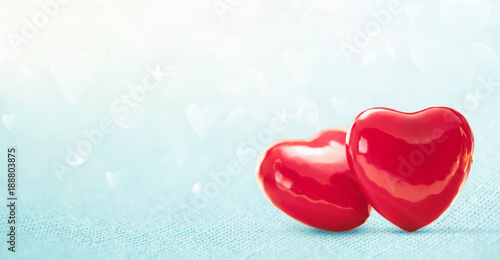 Two Hearts On Shiny Blue Background. Valentines day greeting car