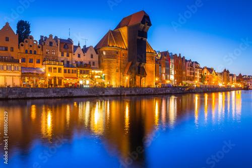 Fotobehang Schip Gdansk at night with historic port crane reflected in Motlawa river, Poland