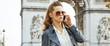 fashion-monger near Arc de Triomphe in Paris using mobile phone