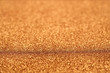 Landscape image at 45 degree angle of gold glitter background iwith blur