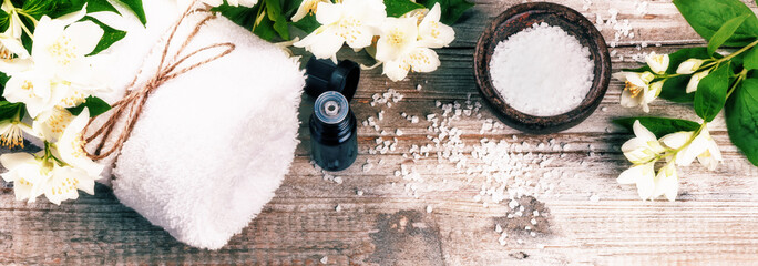 Spa setting with jasmine flowers and essential oil. Wellness concept © Grecaud Paul