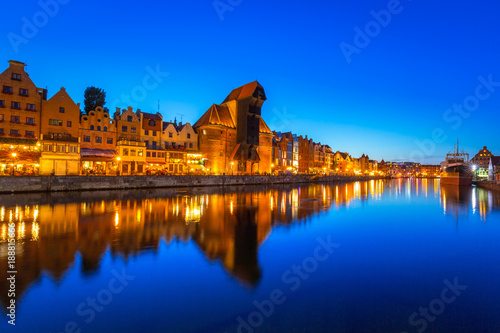 Keuken foto achterwand Schip Gdansk at night with historic port crane reflected in Motlawa river, Poland