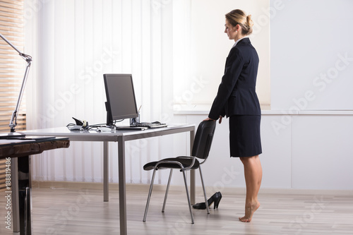 Businesswoman Stretching Her Legs