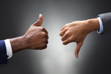 Hands Showing Thumbs Up And Thumbs Down Signs - 188828666