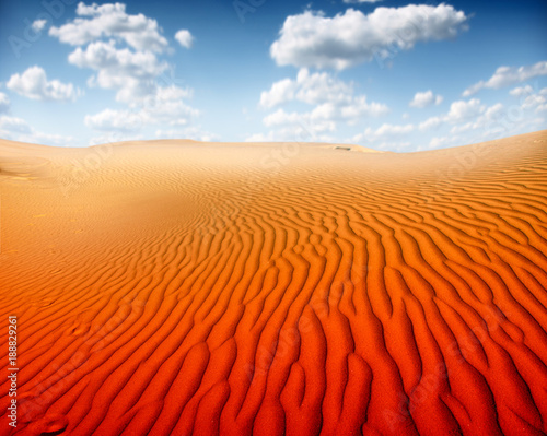 Fotobehang Rood Sunset over the Sahara Desert