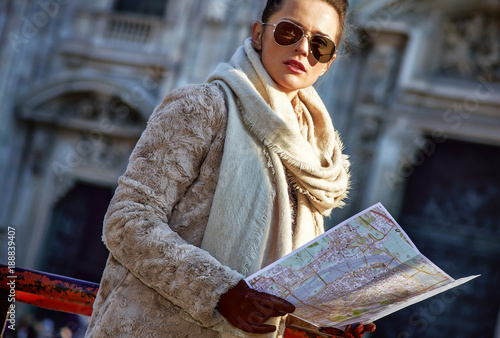 In de dag Milan modern woman in Milan, Italy with map looking into distance