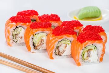 Delicious Philadelphia sushi rolls with rice, avocado, caviar, cream cheese and salmon on light background