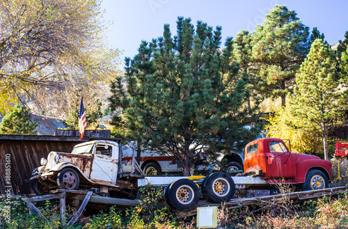 Two Vintage Trucks In Salvage Yard