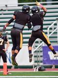 High School Football Players Celebrating a Touchdown