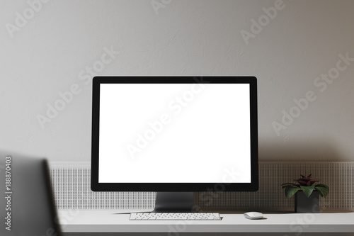 White computer screen on a wooden table white