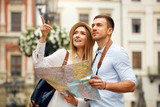 Couple With Map On Travel Vacations, Sightseeing - 188880841