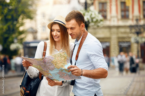Couple With Map On Travel Vacations, Sightseeing