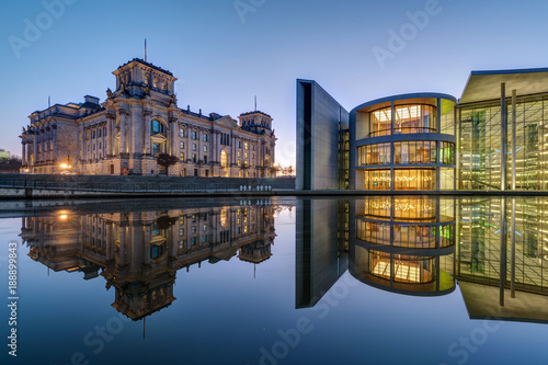 Leinwandbild Motiv The famous Reichtsag and the Paul-Loebe-Haus at the river Spree in Berlin at dawn