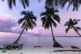 Pink dusk at deserted tropical beach in Indonesia