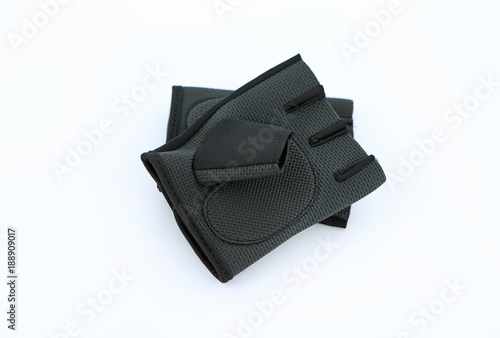A pair of leather gym gloves isolated on white.