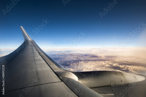 View above the clouds from an airplane - 188913228