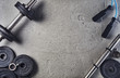 Leinwanddruck Bild - Fitness or bodybuilding concept background. Product photograph of old iron dumbbells on grey, conrete floor in the gym. Photograph taken from above, top view with lots of copy space
