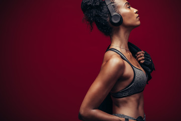 Fitness woman in sportswear and headphones