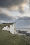 Stunning landscape image of Beachy Headt lighthouse on South Downs National Park during stormy sky - 188947618