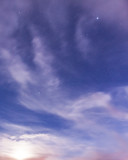 Starry sky and clouds illuminated by moonlight