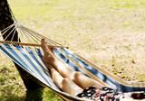 Woman relaxing in the hammock - 188985436