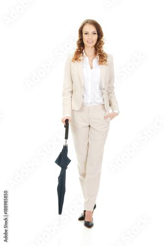 Businesswoman holding an umbrella.