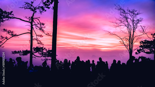 Foto op Canvas Candy roze People watching Sunrise in the morning. Tourists travel relax in the holiday. photograph sunrise in the morning among people. Thailand
