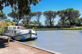 Vacation boat in Canal du Midi, family travel by barge in Southern France  - 189017281