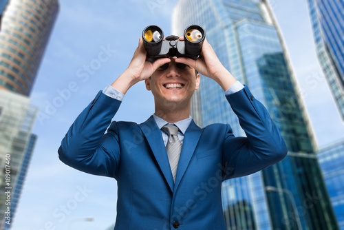 Man watching through binoculars